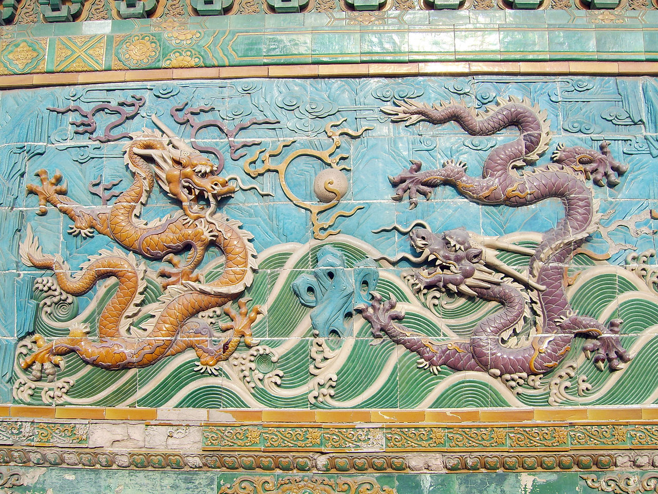 Two dragons playfully fighting over a jewel 二龍戲珠