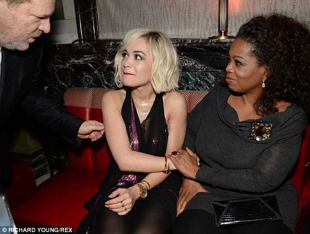 Oprah Winfrey/Harvey Weinstein and young girl