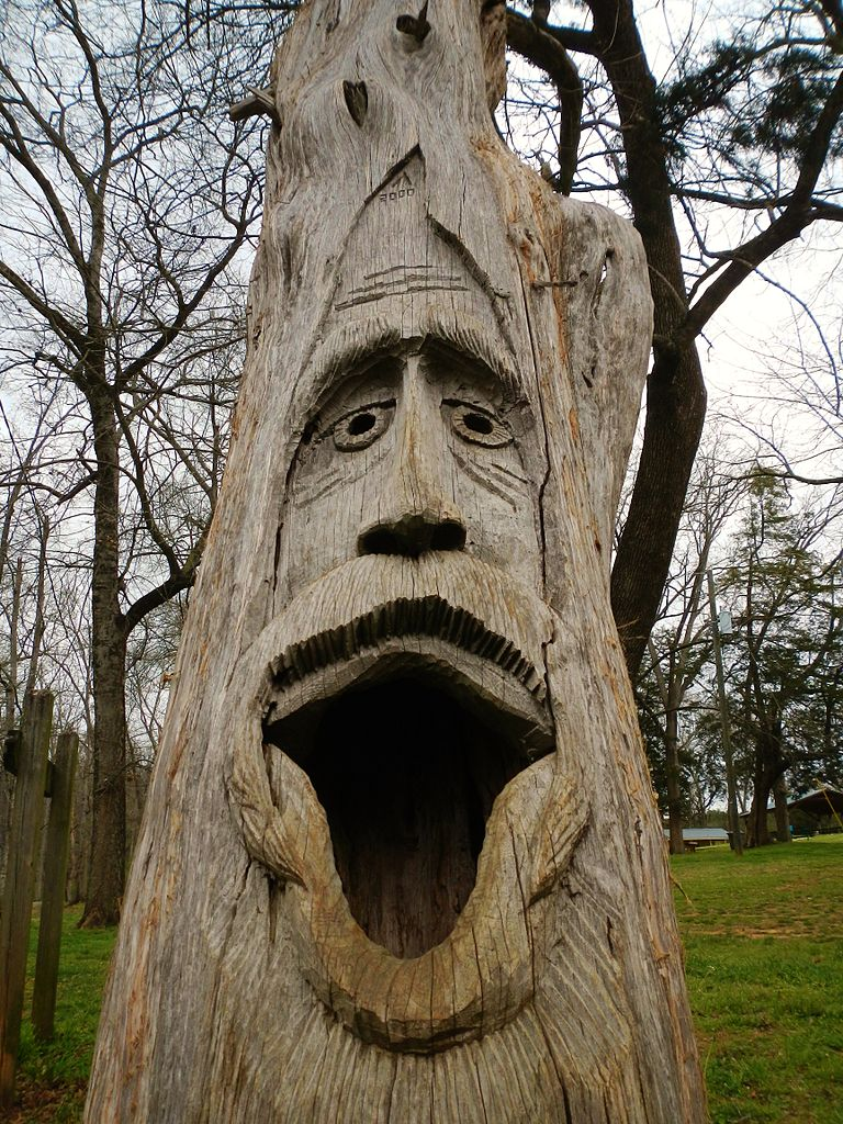 This is a photograph of a wood carving in Orr Park in Montevallo.