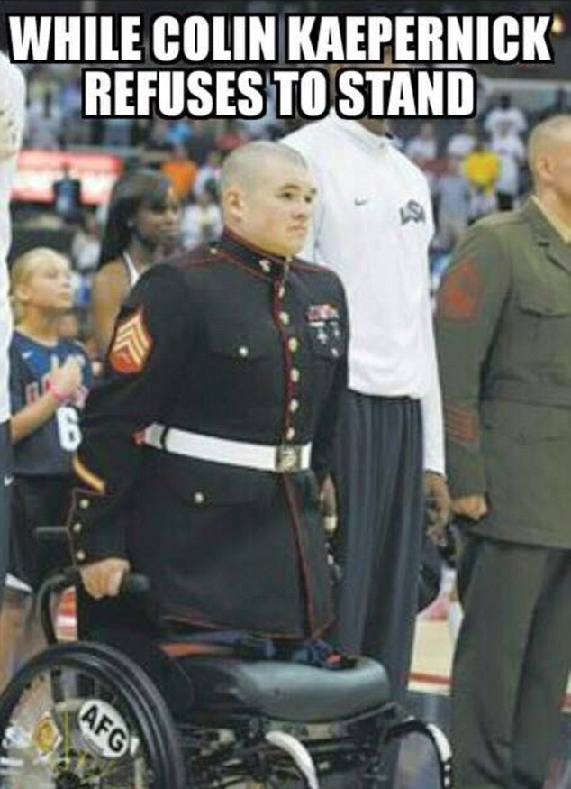 A wounded veteran holding himself upright in his wheelchair for the anthem despite having no legs.