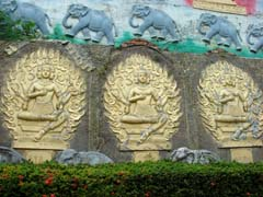 Four-faced buddhas with elephants