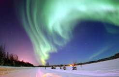 The Aurora Borealis shines above Bear Lake, Alaska