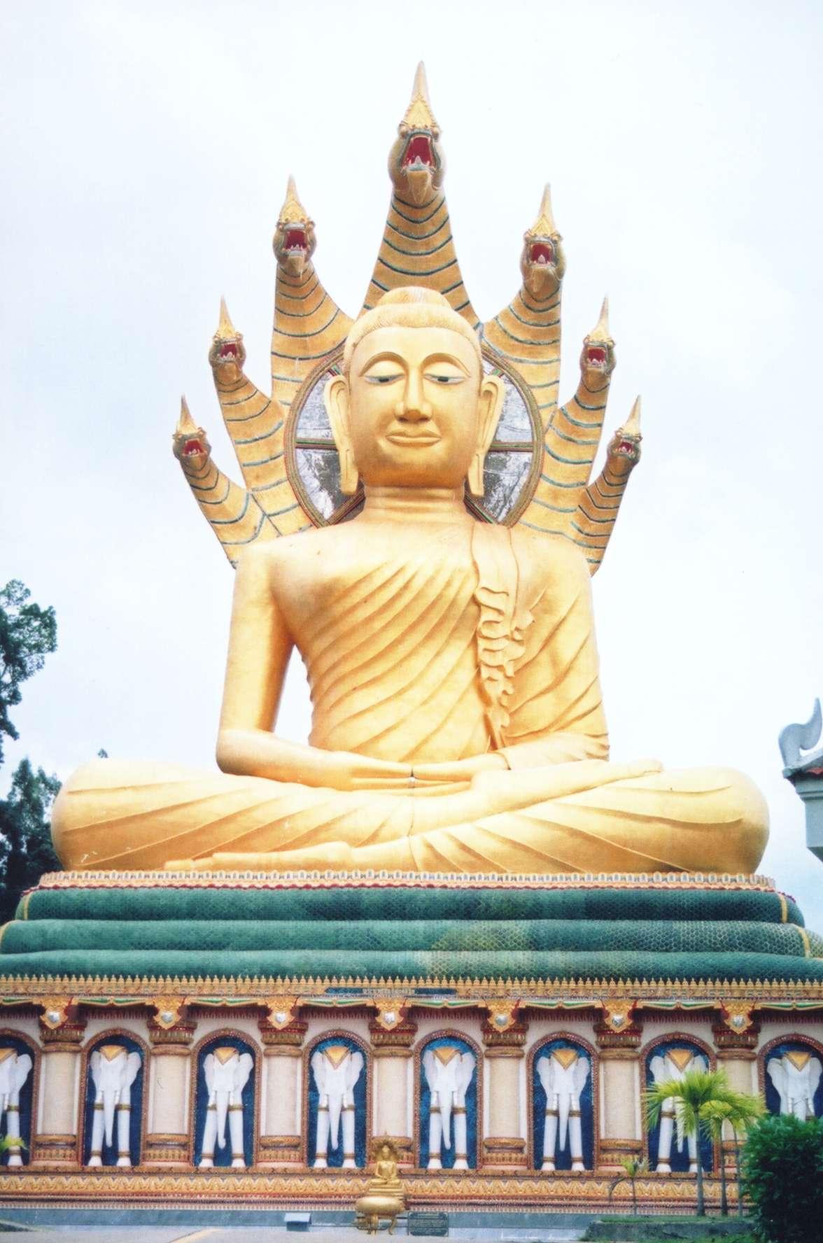 Buddha and mara buddha statue wat bang riang phang nga province thailand biocorpaavc Choice Image