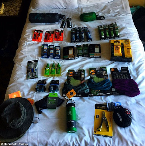 Hope Solo shows off the massive amount of bug repellent laid out on her bed.