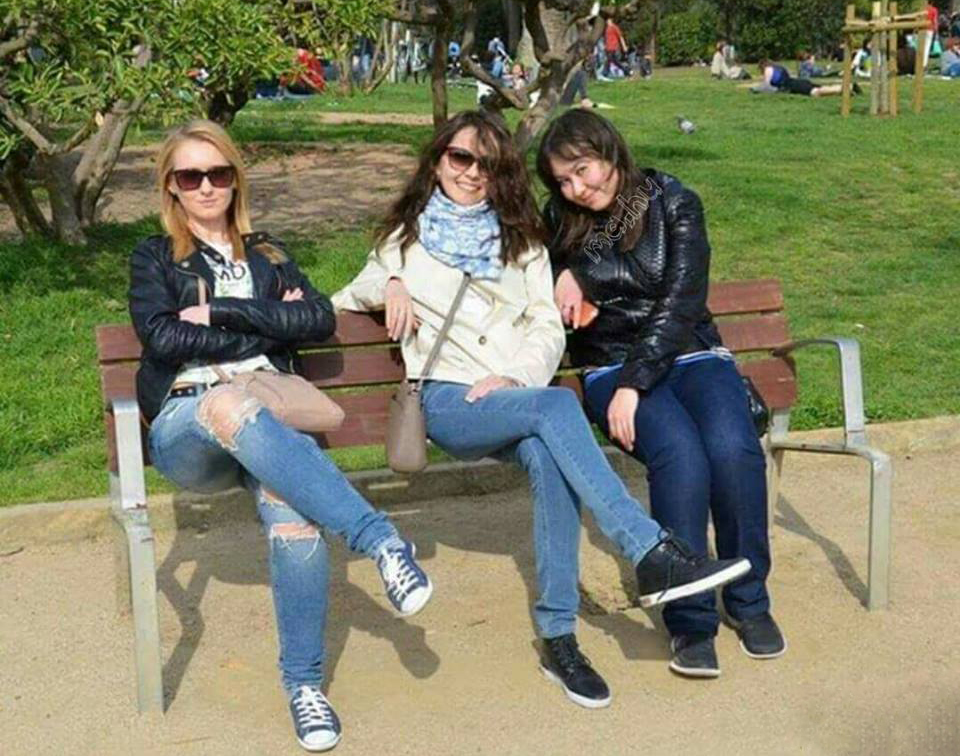 Three women sitting on a park bench illusion